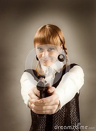 Free Blonde Holding A Gun And Aiming Toward Camera Royalty Free Stock Photos - 13284378