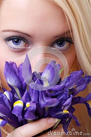Blonde with iris flowers