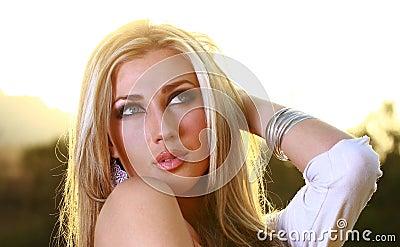 Blonde lady in glowing sun