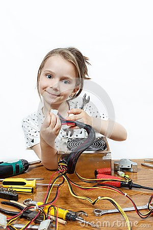 Blonde little girl repair a computer component Stock Photo