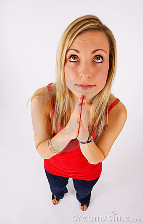 Blonde looking up and praying