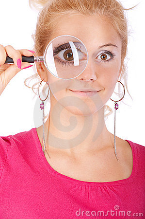Blonde looks through magnifier