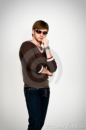 Blonde man in modern sweater and sunglasses