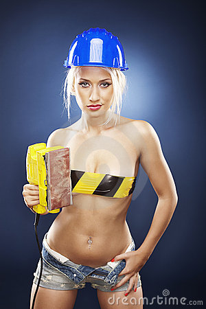 Blonde model with an electric sander.
