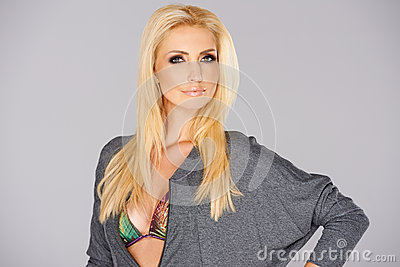 Blonde Model posing isolated on gray