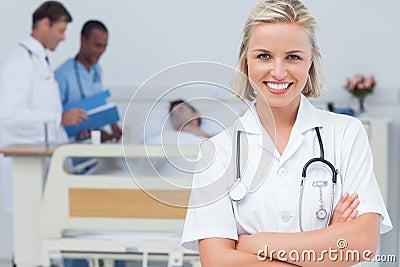 Blonde nurse crossing her arms
