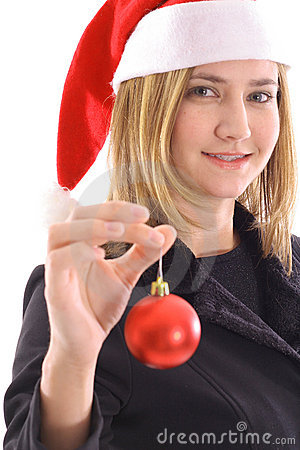 Blonde santa girl holding ornament