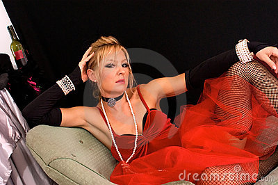 Blonde sitting wearing fishnets