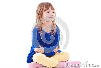 Blonde smiling little girl sitting
