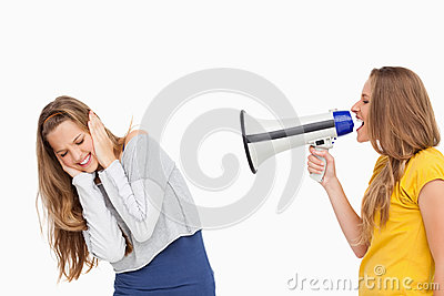Blonde student using a loudspeaker on a other girl
