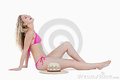 Blonde teenager sitting down and leaning her head