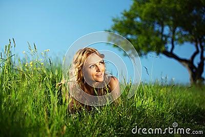 Blonde under tree
