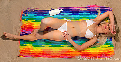 Blonde in white bikini sunbathing