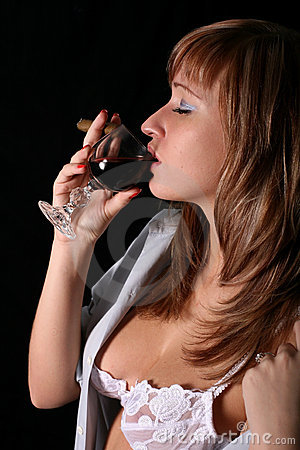 Blonde with wine and cigar in lingerie