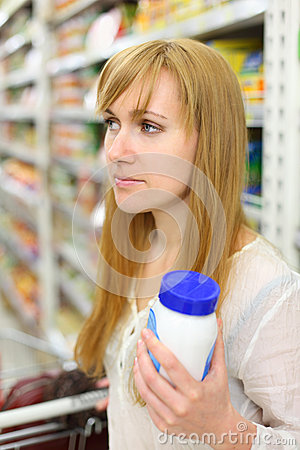 Blonde wistful girl keeps salt in store