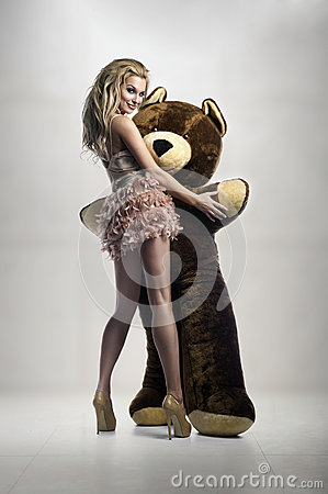 Free Blonde With Huge Teddybear Royalty Free Stock Photo - 30238475