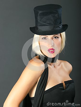 Blonde woman in black hat.