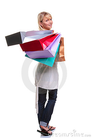 Blonde woman carrying shopping bags