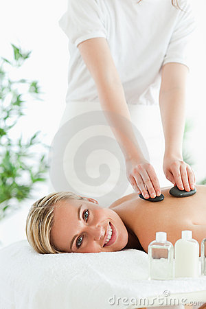 Blonde woman experiencing a stone therapy