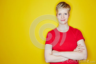 Blonde woman with her arms crossed