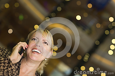 Blonde Woman On Her Cell Phone in the City Lights