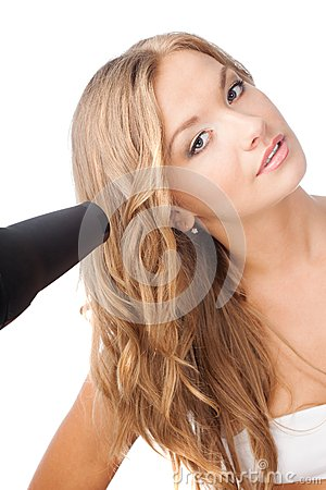 Blonde woman holding hairdryer