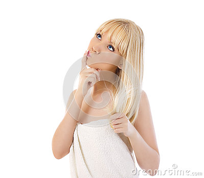 Blonde woman holding her hair and thinking
