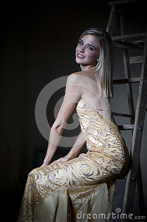 Free Blonde Woman In Sexy Golden Evening Dress Stock Image - 69037701