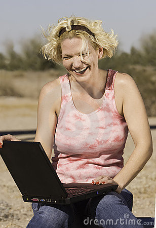 Blonde Woman with a Laptop Computer