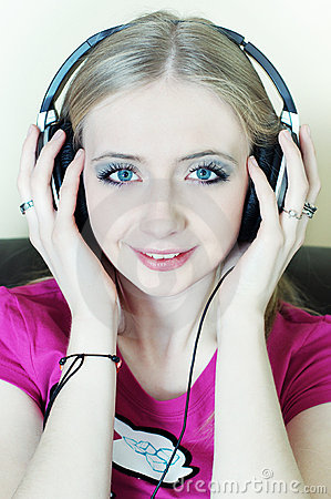 Blonde woman listening to music smiling