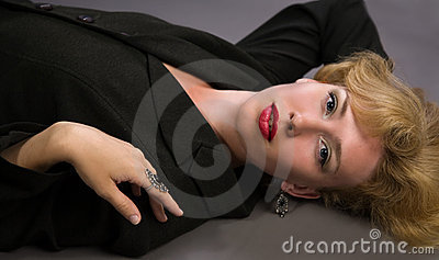 Blonde woman lying on the floor