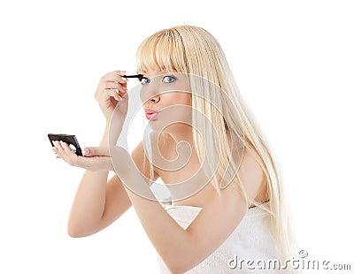 Blonde woman making make up around the eyes