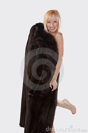 Blonde Woman With A Mink Coat