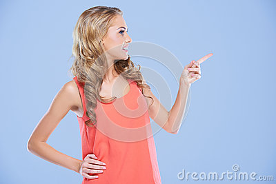 Blonde woman pointing to the right