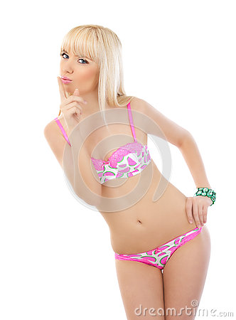 Blonde woman posing in pink lingerie