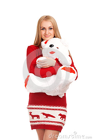 Blonde woman posing with toy bear