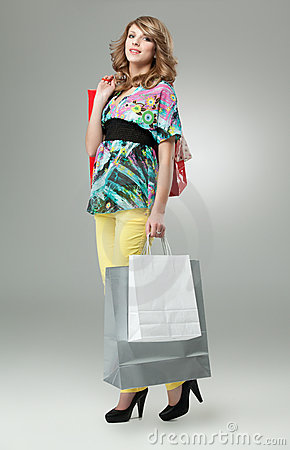 Blonde woman shopping bags