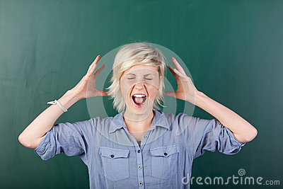 Blonde Woman Shouting By Chalkboard