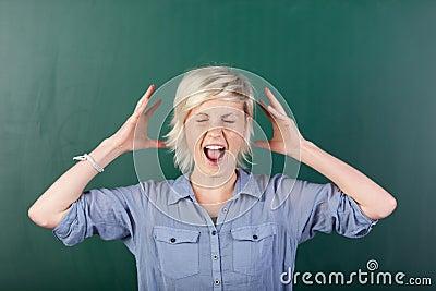 Blonde Woman Shouting By Chalkboard