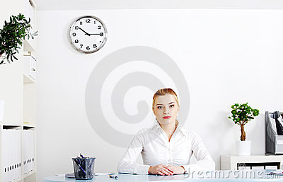 Blonde woman sitting in her office.