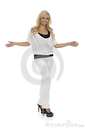 Blonde woman standing arms wide open