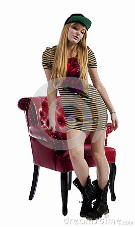 Blonde woman standing by a red chair