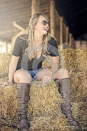 Blonde woman on straw bale