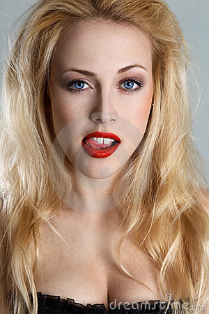 Blonde woman with tongue out
