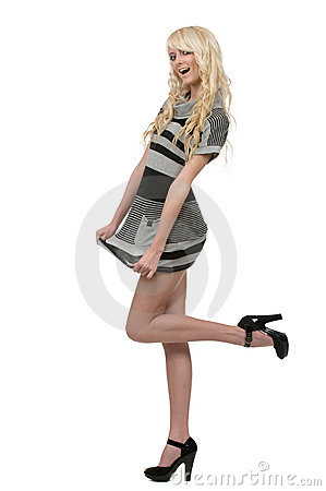 Blonde woman wearing striped dress and black hig