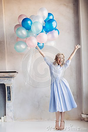 Free Blonde Woman With Balloons Celebrates Something Royalty Free Stock Images - 108891129