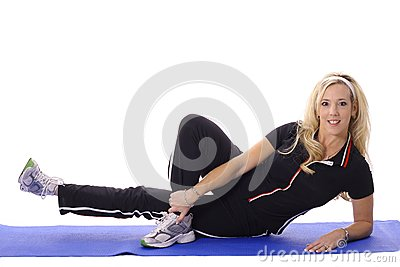 Blonde working out leg lifts