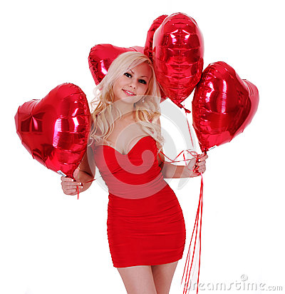 Blonde young woman with balloons for Valentines day