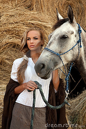Blondie girl with horse