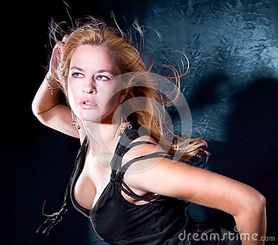 blondie woman with spreading hair dancing